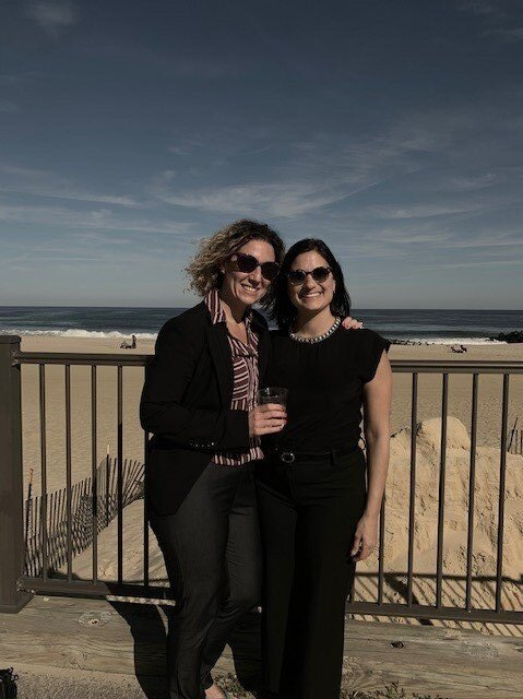 Rosanna and Filomena smiling on a beach front.